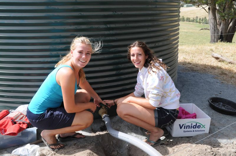 2009 November Sanne (Holl) and Cecile (Holl) repairing watertank