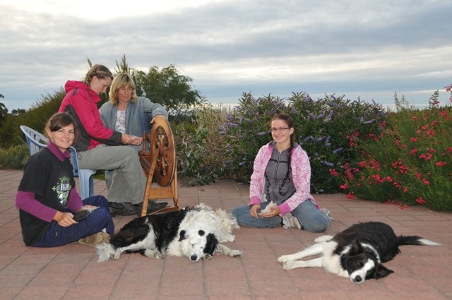 2012 January Manuela (Ger), Yana (Ger), Ruth and Maelin (Fra) learning to spin home-grown wool