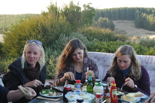 2012 January Sandra (Swe), Manuela (Ger) and Jana (Ger) sharing an evening BBQ meal